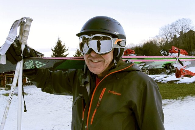 In this Nov. 26, 2019, photo skier Biff Stulgis stands at the base of Sugarbush Resort in Warren, Vt. Stulgis said he started wearing a helmet about 15 years ago after he hit a tree. A study of ski injuries in New Hampshire and Vermont over an eight-year period found that skiers wearing helmets were less likely to have skull fractures, but were more likely to suffer severe injuries including bleeding in the brain. (AP Photo/Lisa Rathke)