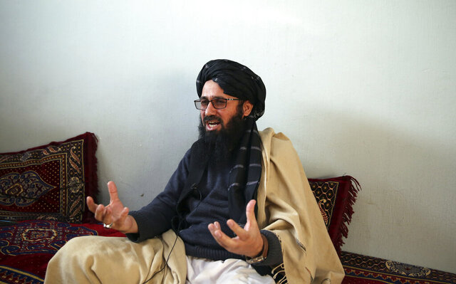 In this Saturday, Dec. 14, 2019, photo, Maulvi Niaz Mohammad, 45, speaks during an interview with The Associated Press inside the Pul-e-Charkhi jail in Kabul, Afghanistan.  Thousands of Taliban prisoners jailed as insurgents see a peace deal being hammered out in Qatar as their ticket to freedom. Prisoner release is a key pillar of any agreement the U.S. strikes with the Taliban to end Afghanistan's 18-year war.   (AP Photo/Rahmat Gul)