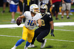 Los Angeles Chargers quarterback Justin Herbert (10) scrambles under pressure fromNew Orleans Saints defensive tackle Sheldon Rankins (98) in the second half of an NFL football game in New Orleans, Monday, Oct. 12, 2020. (AP Photo/Brett Duke)