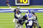 Dallas Cowboys quarterback Dak Prescott, left, throws behind a block by Ezekiel Elliott (21) during the second half of an NFL football game against the Los Angeles Rams Sunday, Sept. 13, 2020, in Inglewood, Calif. (AP Photo/Ashley Landis)