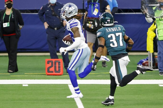 Dallas Cowboys wide receiver CeeDee Lamb (88) heads to the end zone past Philadelphia Eagles cornerback Grayland Arnold (37) after catching a pass for a touchdown in the second half of an NFL football game in Arlington, Texas, Sunday, Dec. 27. 2020. (AP Photo/Michael Ainsworth)