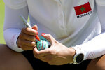Maha Haddioui, of Morocco, marks her golf ball during a practice round prior to the women's golf event at the 2020 Summer Olympics, Tuesday, Aug. 3, 2021, at the Kasumigaseki Country Club in Kawagoe, Japan. (AP Photo/Andy Wong)