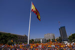 Thousands gather during a protest against the Spanish government's plan to issue pardons to a dozen imprisoned Catalan separatist leaders, Madrid, Sunday, 13 June, 2021. The demonstration has been organized by a civil society group in defense of the nation's unity that chose to hold it at a central square that has become popular for far-right political rallies. (AP Photo/Bernat Armangue)