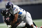 Tennessee Titans linebacker Reggie Gilbert (93) hits Atlanta Falcons wide receiver Mohamed Sanu (12) during the second half of an NFL football game, Sunday, Sept. 29, 2019, in Atlanta. The Tennessee Titans won 24-10. (AP Photo/John Bazemore)
