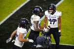 Northwestern wide receiver Ramaud Chiaokhiao-Bowman, center, celebrates a touchdown against Purdue with wide receiver Bryce Kirtz (17) during the first half of an NCAA college football game in West Lafayette, Ind., Saturday, Nov. 14, 2020. (AP Photo/Michael Conroy)