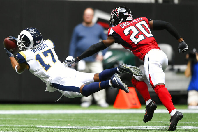 Los Angeles Rams wide receiver Robert Woods (17) makes the catch against Atlanta Falcons defensive back Kendall Sheffield (20) during the first half of an NFL football game, Sunday, Oct. 20, 2019, in Atlanta. (AP Photo/John Amis)