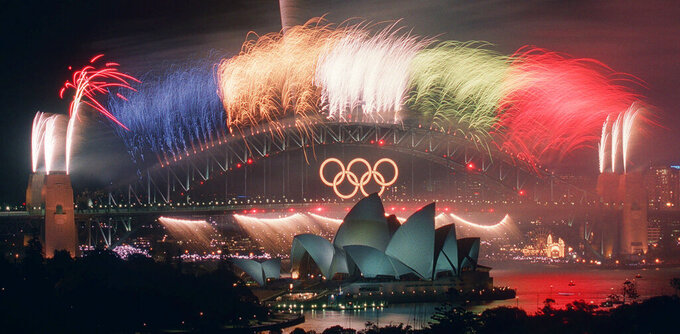 FILE - In this Oct. 1, 2000, file photo, the closing ceremony fireworks for the Sydney 2000 Olympic Games erupt over the Sydney Harbor Bridge and Opera House in Australia. An Australian push to host the 2032 Olympics was elevated overnight to the status of preferred bid, and the people of Brisbane and southeast Queensland state woke up to the news Thursday, Feb. 25, 2021. (AP Photo/Steve Holland, File)