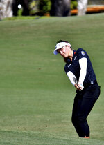 Brooke Henderson chips to the green on the sixth hole during the 2019 CME Group Tour Golf Championship at the Tiburón Golf Club, Friday, Nov. 22, 2019 in Naples, Fla. (Chris Tilley/Naples Daily News via AP)