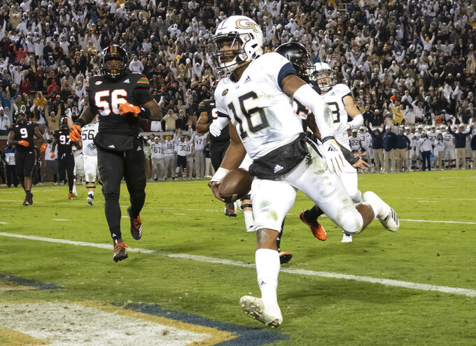 Georgia Tech quarterback TaQuon Marshall (16) scores a touchdown during the first half of an NCAA college football game against Miami, Saturday, Nov. 10, 2018, in Atlanta. (AP Photo/John Amis)