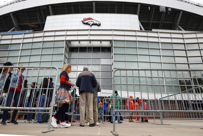 Fans queue up to attend a memorial for Denver Broncos owner Pat Bowlen Tuesday, June 18, 2019 at Mile High Stadium, the NFL football team's home in Denver. Bowlen, who has owned the franchise for more than three decades, died last Thursday. (AP Photo/David Zalubowski)