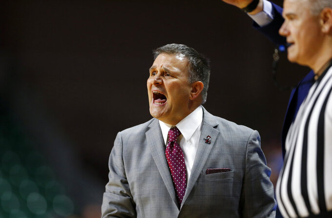 New Mexico State coach Chris Jans calls out to his players during an NCAA college basketball game against Grand Canyon for the Western Athletic Conference men's tournament championship Saturday, March 16, 2019, in Las Vegas. New Mexico State won 89-57. (AP Photo/Steve Marcus)