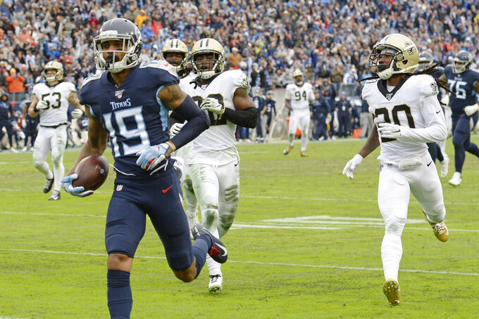 Tennessee Titans wide receiver Tajae Sharpe (19) scores a touchdown on a 36-yard pass reception against the New Orleans Saints in the second half of an NFL football game Sunday, Dec. 22, 2019, in Nashville, Tenn. (AP Photo/Mark Zaleski)