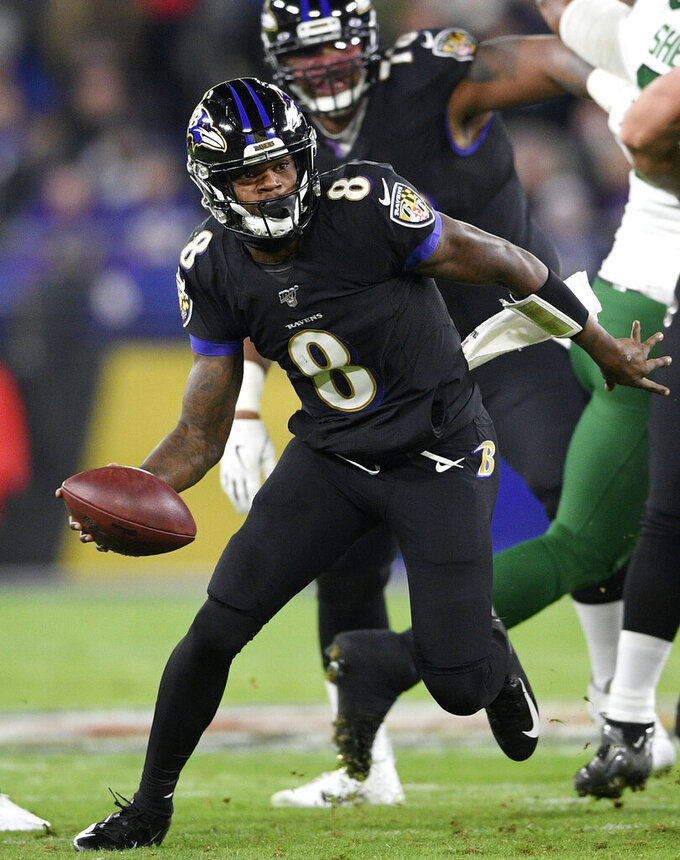 FILE - In this Dec. 12, 2019, file photo, Baltimore Ravens quarterback Lamar Jackson (8) scrambles against the New York Jets during the first half of an NFL football game, in Baltimore. The Baltimore Ravens bring a 12-game winning streak into their playoff matchup with the Tennessee Titans in Saturday night. (AP Photo/Nick Wass, File)
