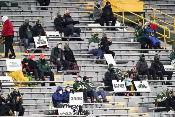 A limited number of fans at Lambeau Field watch during the first half of an NFL football game between the Green Bay Packers and the Chicago Bears Sunday, Nov. 29, 2020, in Green Bay, Wis. (AP Photo/Morry Gash)