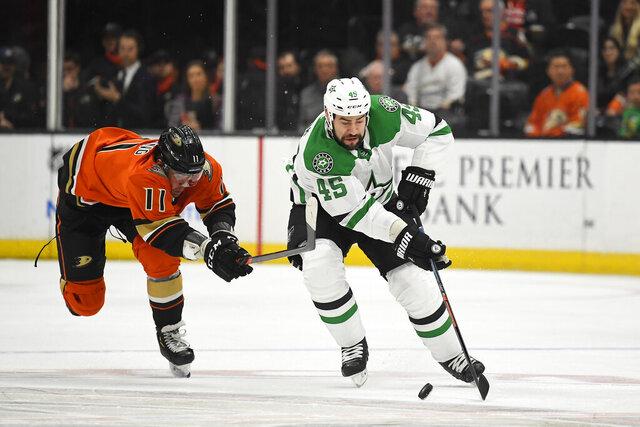 Anaheim Ducks right wing Daniel Sprong, left, reaches for Dallas Stars defenseman Roman Polak as Polak takes the puck during the first period of an NHL hockey game Thursday, Jan. 9, 2020, in Anaheim, Calif. (AP Photo/Mark J. Terrill)