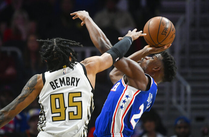 Philadelphia 76ers guard Jimmy Butler, right, is fouled by Atlanta Hawks forward DeAndre' Bembry (95) during the first half of an NBA basketball game Saturday, March 23, 2019, in Atlanta. (AP Photo/John Amis)