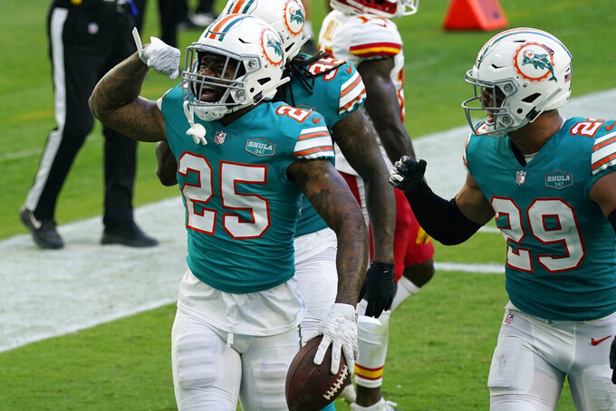 Miami Dolphins cornerback Xavien Howard (25) celebrates after intercepting a pass during the second half of an NFL football game against the Kansas City Chiefs, Sunday, Dec. 13, 2020, in Miami Gardens, Fla. (AP Photo/Lynne Sladky)