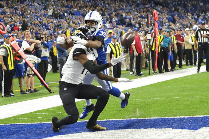 Jacksonville Jaguars' DJ Chark Jr. (17) makes a touchdown reception against Indianapolis Colts' Marvell Tell (39) during the second half of an NFL football game, Sunday, Nov. 17, 2019, in Indianapolis. Indianapolis won 33-13. (AP Photo/AJ Mast)