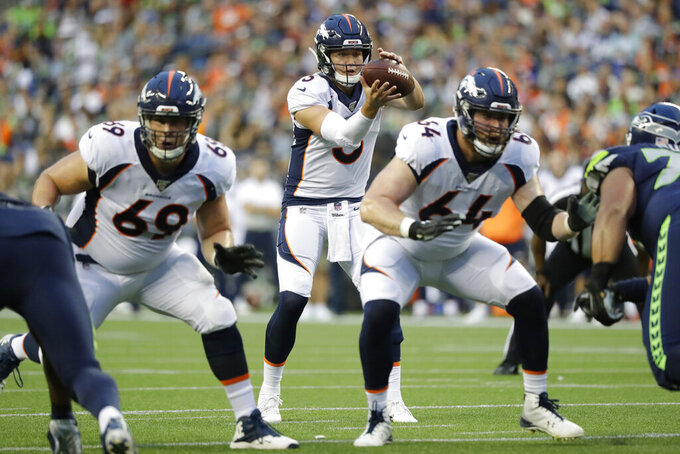 Denver Broncos quarterback Drew Lock (3) takes the snap behind tackle Jake Rodgers (69) and center Jake Brendel (64) during the first half of the team's NFL football preseason game against the Seattle Seahawks, Thursday, Aug. 8, 2019, in Seattle. (AP Photo/Elaine Thompson)
