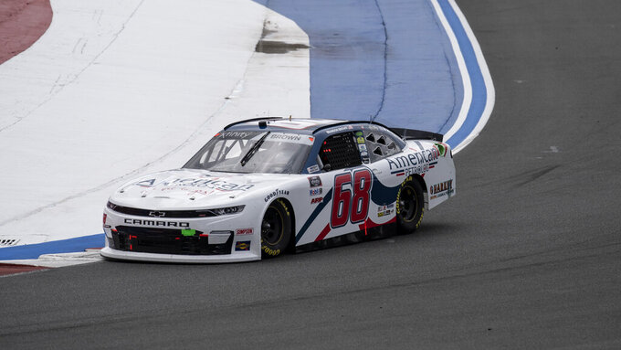 NASCAR Xfinity Series driver Brandon Brown (68) races during the NASCAR Xfinity auto racing race at the Charlotte Motor Speedway Saturday, Oct. 9, 2021, in Concord, N.C. (AP Photo/Matt Kelley)