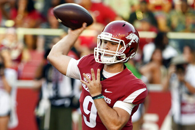FILE - In this Sept. 15, 2018, file photo, Arkansas quarterback John Stephen Jones drops back to pass against North Texas in the second half of an NCAA college football game in Fayetteville, Ark. Jones grandfather is Arkansas alum and Dallas Cowboys owner Jerry Jones. (AP Photo/Michael Woods, File)