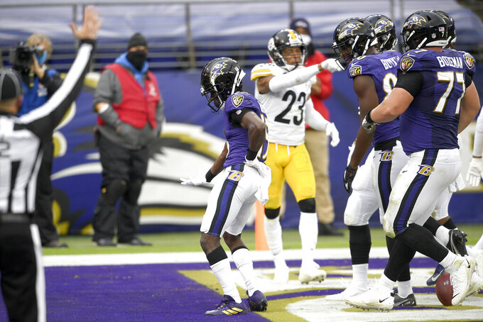 Baltimore Ravens wide receiver Marquise Brown, left, celebrates after catching a touchdown pass from quarterback Lamar Jackson, not visible, against the Pittsburgh Steelers during the second half of an NFL football game, Sunday, Nov. 1, 2020, in Baltimore. (AP Photo/Nick Wass)