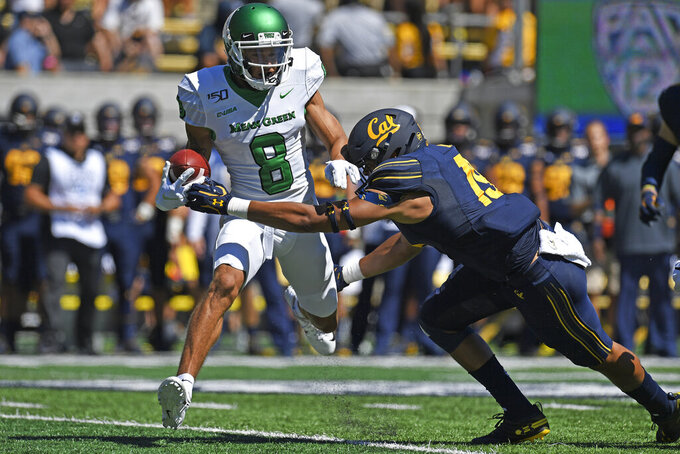 California's Cameron Goode (19) tackles North Texas' Rico Bussey Jr. (8) during the first half of an NCAA college football game at Memorial Stadium in Berkeley, Calif., on Saturday, Sept. 14, 2019. (Jose Carlos Fajardo/San Jose Mercury News via AP)
