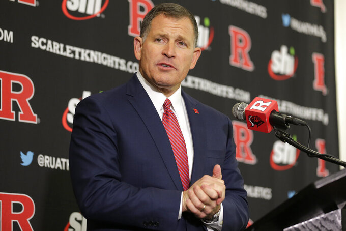 FILE - In this Dec. 4, 2019, file photo, Rutgers NCAA college football head coach Greg Schiano speaks at a news conference in Piscataway, N.J. Speaking to the media for the first time since the COVID-19 pandemic shut down the Big Ten Conference university and its athletic programs last month, Schiano said Thursday, April 16, 2020, his biggest concern is the health of his players and their families. (AP Photo/Seth Wenig, Fle)