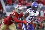 Minnesota Vikings running back Dalvin Cook (33) runs in front of San Francisco 49ers linebacker Dre Greenlaw during the second half of an NFL divisional playoff football game, Saturday, Jan. 11, 2020, in Santa Clara, Calif. (AP Photo/Marcio Jose Sanchez)