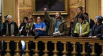 In this Tuesday, Dec. 4, 2018, photo, people take turns speaking to protest the lame duck legislation in the Capitol Rotunda in Lansing, Mich. The incoming Democratic governor of Wisconsin said Wednesday that he plans to make a personal appeal to his defeated rival, Gov. Scott Walker, to veto far-reaching GOP legislation that would restrict the new administration's powers. (Robert Killips/Lansing State Journal via AP)