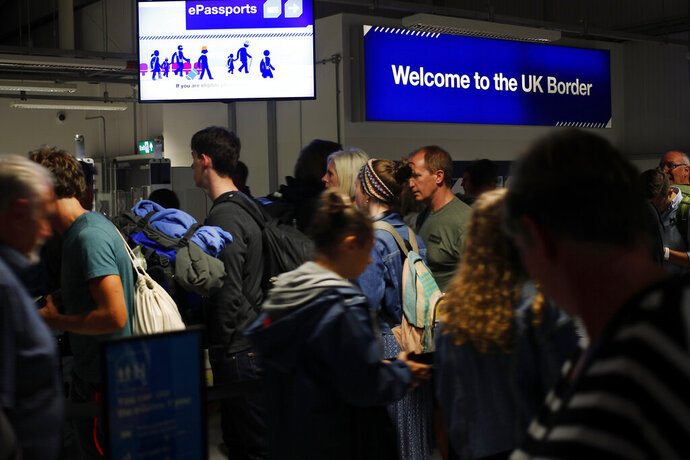 In this picture taken Saturday, Aug. 31, 2019, passengers arrive at Edinburgh Airport, in Edinburgh, Scotland. Disgruntlement over Brexit and political chaos in London are breathing new life into the push for Scottish independence.  Scots voted in 2014 to remain in Britain but now they are having second thoughts and independence advocates want another referendum. (AP Photo/Francois Mori)