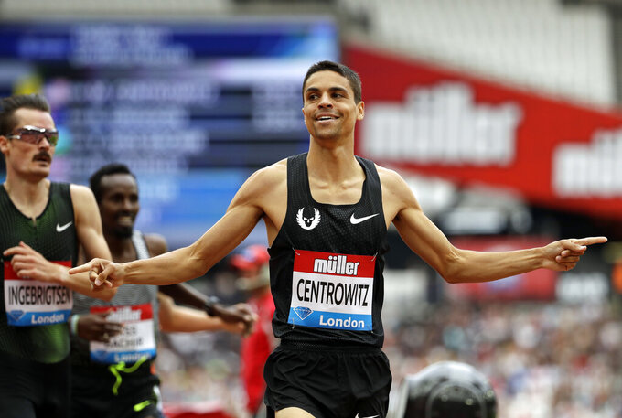 FILE - In this Sunday, July 22, 2018, file photo, United States' Matthew Centrowitz celebrates after winning the men's 1500 meters race at the IAAF Diamond League athletics meeting at London Stadium in London. Private, touching moment between loved ones won't be happening at the pandemic-delayed Tokyo Olympics. No spectators — local or foreign — will be allowed at the majority of venues, where athletes will hang medals around their own necks to protect against spreading the coronavirus. No handshakes or hugs on the podium, either.(AP Photo/Matt Dunham, File)