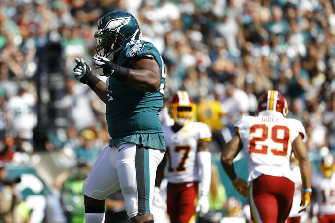Philadelphia Eagles' Fletcher Cox, left, celebrates after tackling Washington Redskins' Derrius Guice during the second half of an NFL football game Sunday, Sept. 8, 2019, in Philadelphia. (AP Photo/Michael Perez)