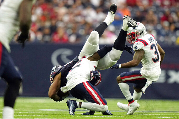 New England Patriots safety Devin McCourty, bottom, tackles Houston Texans tight end Pharaoh Brown (85) during the second half of an NFL football game Sunday, Oct. 10, 2021, in Houston. (AP Photo/Eric Christian Smith)