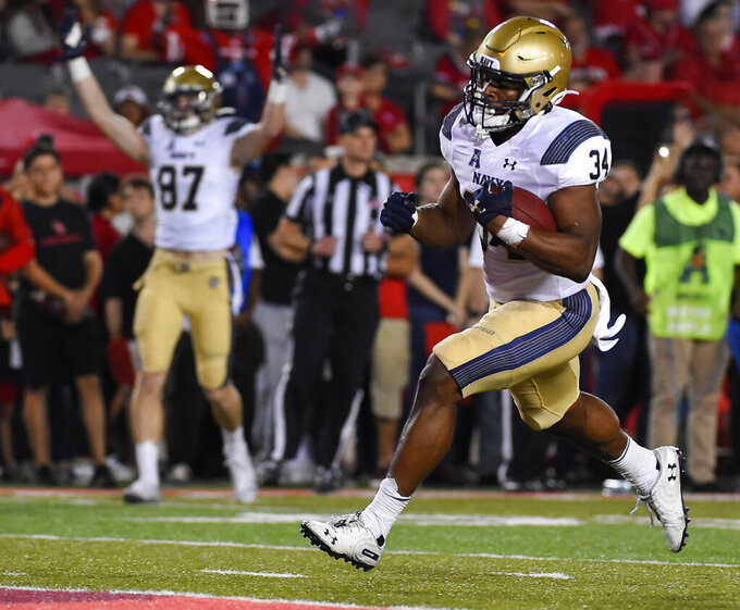 Navy fullback Jamale Carothers (34) runs in to the end zone for a touchdown during the first half of an NCAA college football game against Houston, Saturday, Nov. 30, 2019, in Houston. (AP Photo/Eric Christian Smith)