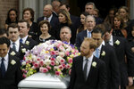 Former President George W. Bush accompanied by former first lady Laura Bush follow as pallbearers carry the casket of former first lady Barbara Bush after a funeral service at St. Martin's Episcopal Church, Saturday, April 21, 2018, in Houston. (AP Photo/Evan Vucci)