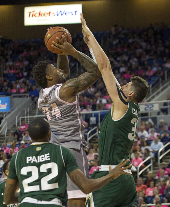 Nevada forward Jordan Caroline (24) shoots over Colorado State center Nico Carvacho (32) during the first half of an NCAA college basketball game in Reno, Nev., Wednesday, Jan. 23, 2019. (AP Photo/Tom R. Smedes)