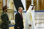 Russian President Vladimir Putin, second left, and Abu Dhabi Crown Prince Mohamed bin Zayed al-Nahyan attend the official welcome ceremony in Abu Dhabi, United Arab Emirates, Tuesday, Oct. 15, 2019. (AP Photo/Alexander Zemlianichenko, Pool)