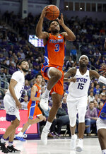 Florida guard Jalen Hudson (3) breaks to the basket after getting past TCU's Alex Robinson, left, and JD Miller (15) in the first half of an NCAA college basketball game in Fort Worth, Texas, Saturday, Jan. 26, 2019. (AP Photo/Tony Gutierrez)