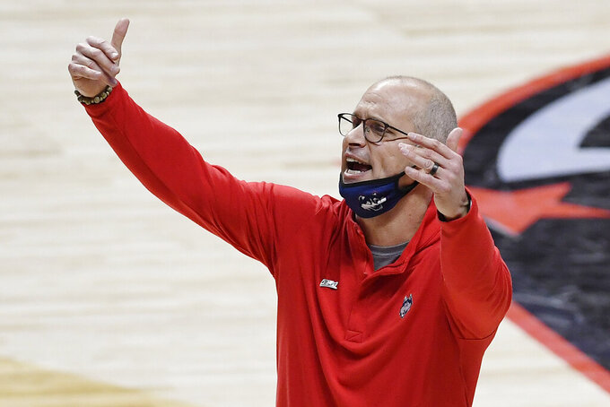Connecticut coach Dan Hurley calls out to the team during the first half of an NCAA college basketball game against Southern California, Thursday, Dec. 3, 2020, in Uncasville, Conn. (AP Photo/Jessica Hill)