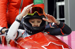 FILE - In this Feb. 21, 2018, file photo, Canada driver Kaillie Humphries and Phylicia George, obscured at left, celebrate after their bronze medal winning final heat during the women's two-man bobsled final at the 2018 Winter Olympics in Pyeongchang, South Korea. Humphries _ one of the best pilots in the history of her sport _ has traded her red and white Canadian gear for red, white and blue U.S. apparel. No longer racing for her homeland of Canada, Humphries is now officially a member of USA Bobsled's national team after a nearly two-year saga that saw her not only claim that she was verbally and mentally abused by a Canadian coach to the point where she no longer felt safe but that her now-former national team simply discarded her. (AP Photo/Wong Maye-E, File)