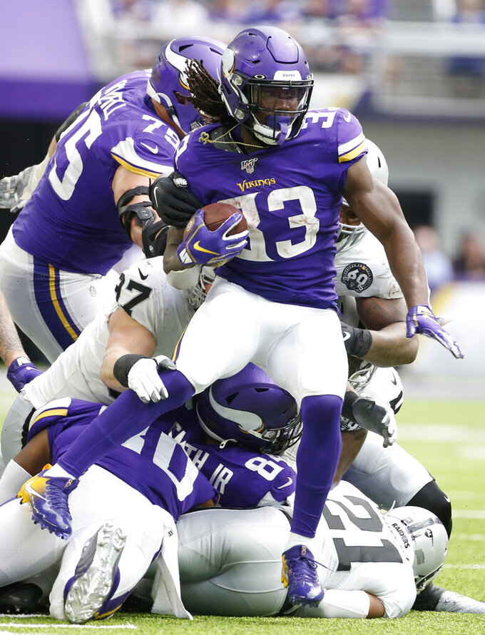 Minnesota Vikings running back Dalvin Cook (33) tries to break a tackle during the second half of an NFL football game against the Oakland Raiders, Sunday, Sept. 22, 2019, in Minneapolis. (AP Photo/Bruce Kluckhohn)