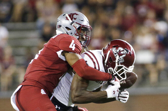 New Mexico State wide receiver Robert Downs III, right, catches a pass while defended by Washington State cornerback Marcus Strong during the first half of an NCAA college football game in Pullman, Wash., Saturday, Aug. 31, 2019. (AP Photo/Young Kwak)