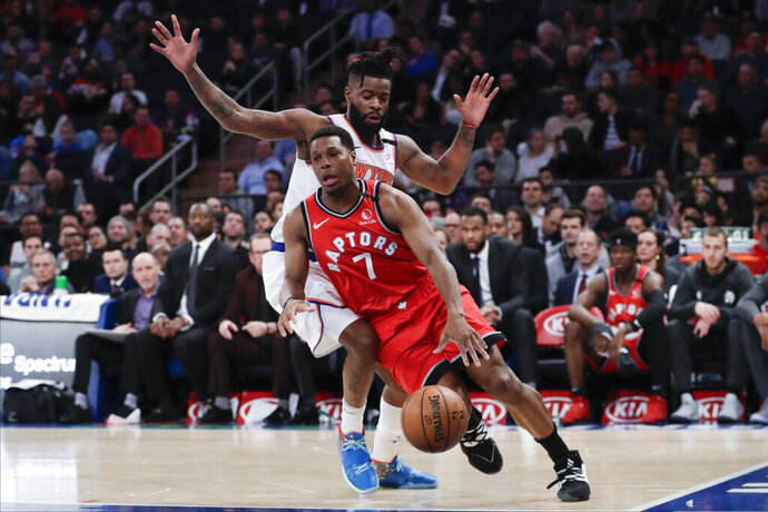 Toronto Raptors' Kyle Lowry (7) drives past New York Knicks' Reggie Bullock during the first half of an NBA basketball game Friday, Jan. 24, 2020, in New York. (AP Photo/Frank Franklin II)