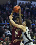 Florida State's Terance Mann (14) drives to the basket as Wake Forest's Sharon Wright, Jr. (2) defends during the second half of their NCAA college basketball game on Saturday, March 9, 2019 in Winston-Salem, N.C. Florida State beat Wake Forest 65 to 57. (AP Photo/Woody Marshall)