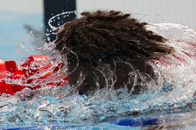 Edgar Richardson Iro, of Solomon Islands, shakes water out of his hair after a heat of the men's 100-meter freestyle at the 2020 Summer Olympics, Tuesday, July 27, 2021, in Tokyo, Japan. (AP Photo/Petr David Josek)