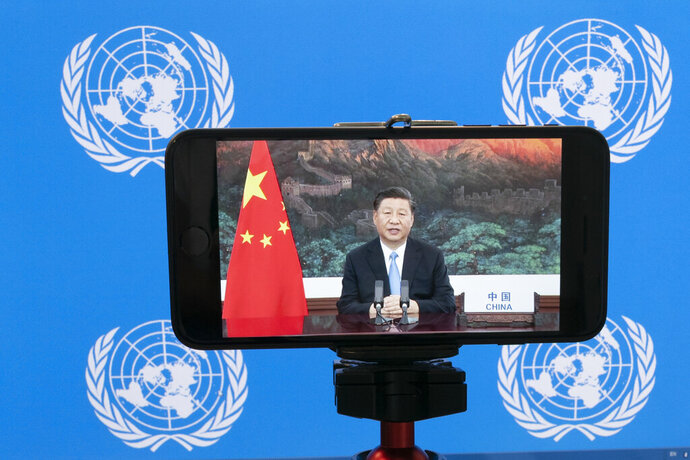 Chinese President Xi Jinping is seen on a video screen remotely addressing the 75th session of the United Nations General Assembly, Tuesday, Sept. 22, 2020, at U.N. headquarters. This year's annual gathering of world leaders at U.N. headquarters will be almost entirely