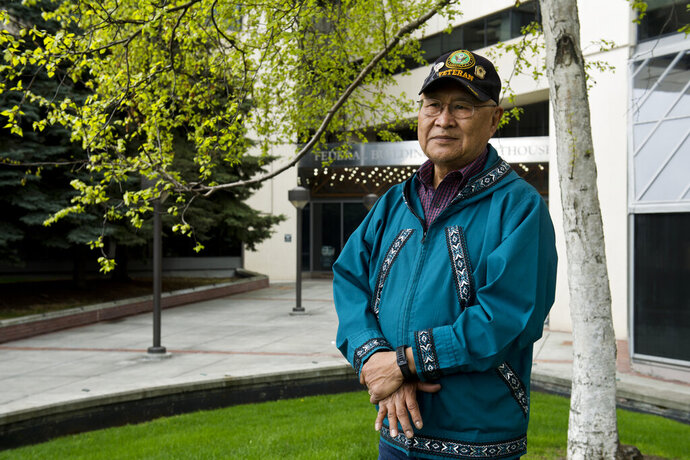 In this photo taken May 6, 2019, is Nelson Angapak standing outside the Federal Building in Anchorage, Alaska. Angapak is advocating for land allotments for Alaska Native veterans who were serving in Vietnam when the allotment program ended in 1971. Congress in March passed a major lands bill that opens the door for more Native veterans to apply for tracts of land of up to 160 acres. It follows a more limited application period in 1998, an opportunity that many veterans said wasn't enough. (Marc Lester/Anchorage Daily News via AP)