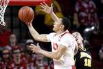 Nebraska's Amir Harris (1) goes to the basket past Iowa's Joe Wieskamp (10) during the first half of an NCAA college basketball game in Lincoln, Neb., Sunday, March 10, 2019. (AP Photo/Nati Harnik)