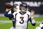 Denver Broncos quarterback Drew Lock (3) looks to throw against the Las Vegas Raiders during the first half of an NFL football game, Sunday, Nov. 15, 2020, in Las Vegas. (AP Photo/Isaac Brekken)